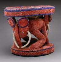 Fon's royal stool, 19th century Bamileke peoples Grasslands, Cameroon Wood, glass beads, raffia cloth 16 1/8 x 17 ¾ x 19 6/8 in.  (41 x 45 x 50 cm.) The Field Museum, 175558 Photograph by John Weinstein