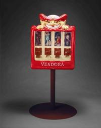 Frank McEntire, Vendora, 2003, plastic candy dispenser, metal stand, and found religious objects, 53 x 23 x 18 inches.  Collection of the Nora Eccles Harrison Museum of Art, Utah State University, Charter Member Endowment Purchase.