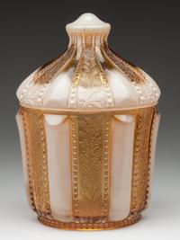 "A covered sugar bowl produced by the Indiana Tumbler and Goblet Co., a Greentown number 450, in the Holly Amber pattern and golden agate color, made circa 1903, 6 5/8"" high, sold for $3,335."