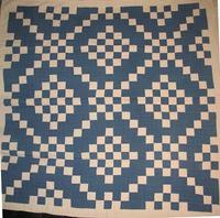 White and Blue Diamond Chain quilt from Laura Fisher.