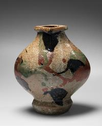 A very rare major work by Kawai Kanjiro, a flattened vessel (henko) with flaring mouth and sançai red, green and black iron-oxide glazes on unglazed Shigaraki clay body, circa 1960