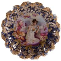 Marked R.S.  Prussia plate, 11.75 inches in diameter, stipple mold, with a fall season portrait decor having poppy highlights and a wonderful cobalt blue border.