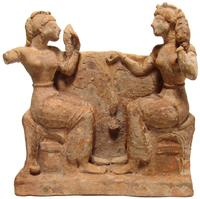 Greek terracotta relief scene from circa the 5th century BC, depicting two women seated on ornate chairs and facing each other, mold-made and partially in the round (est.  $8,000-$12,000).