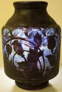 Daum Nancy Art Nouveau classic cased vase, 11 inches tall, with carved black Oriental poppy exterior design, circa 1900 (est.  $5,000-$10,000).