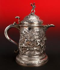 Gorgeous circa 1860s English repousse silver pitcher by R&S Garrand of London, with marks dating it to London around 1861, 8 inches tall (est.  $4,000-$6,000).