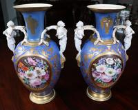 Pair of early Old Paris mantel vases from Rosemont with satyr handles, 19 inches tall.