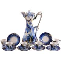 Unmarked R.S.  Prussia chocolate set with an 11.75-inch pot, cobalt blue, with a stylized carnation decor and gold stencil highlights and six demitasse-size cups and saucers.