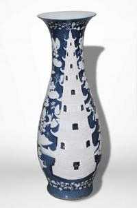 Monumental Chinese porcelain vase made around 1870 with lovely pate-sur-pate pagoda decoration (est.  $10,000-$15,000).