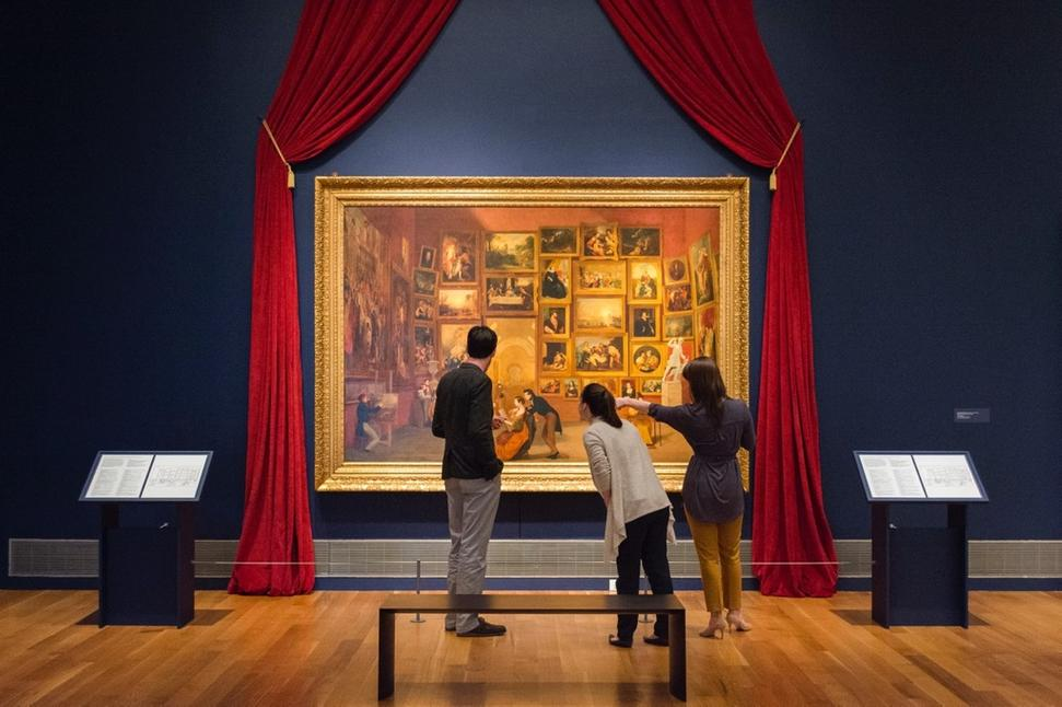 Phil Archer, curator at Reynolda House Museum of American Art, shows visitors Samuel Morse's painting Gallery of the Louvre, now on view at the museum through June 4.  Early prototypes of Morse's other masterwork – the telegraph - are also exhibited.