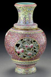 Lot 223 and lot 240, two Impressive Chinese Republic revolving and reticulated porcelain vase within a vase, the openwork finely painted to depict peaches and scrolling lotus, the interior depicting figures reading scrolls and playing games sold for $110,250.00 with an estimates of $8,000-$12,000.00.
