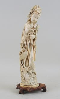 "One of two Chinese carved tusks of ladies amid peonies, each measuring over 13"" high."