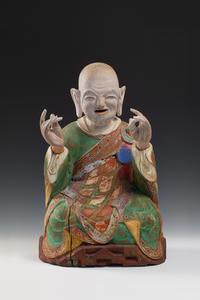 "From Koo New York.  KOREAN: Rare Buddhist Polychrome Wood Figure of a Seated Nahan, Joseon Dynasty, 18th/19th century, original consecrated sutra pages remaining inside head cavity, the front carved with the identifier number ""two"" corresponding to Kanakavatsa (second disciple of historical Sakyamuni Buddha) Height 20 1/2 in.  (52 cm)"