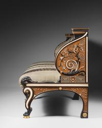 Sir Lawrence Alma-Tadema (English, born Netherlands, 1836–1912), designer; Johnstone, Norman & Co., London, manufacturers; Long Settee, 1884–85.  Ebony, cedar, boxwood, ivory, mother-of-pearl, abalone, brass, glass and red foil, and modern upholstery.  Mugrabi Collection.  Image © J.  Beylard and V.  Luc – Agence Phar, Paris 7.