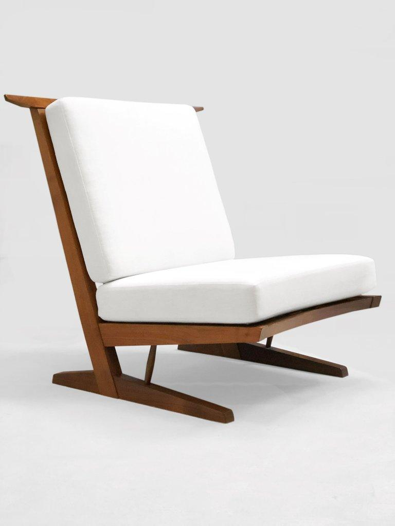 Contemporary art furniture Design conoid Chair In Walnut With Spindled Back And Cushions Upholstered In Linen Fabricated By Nakashima Studios Modern And Contemporary Art Sales Abound At Second Edition Of Tefaf