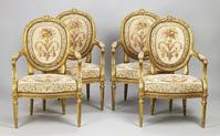 Four Louis XVI style carved gilt-wood and tapestry fauteuils by Gustave-Frédéric Quignon (part of a salon suite), Paris, c1880