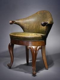 Rare Dutch leather and mahogany musician's chair with low cartouche-shaped back and scroll carved arms on a balloon seat with show apron and bold front cabriole legs ending in scroll feet.  c.1840.