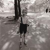 Diane Arbus, American, 1923 – 1971.  Neil Selkirk, American, born England, born 1947.  Child with a toy hand grenade in Central Park, NYC, 1962; printed 1973.  Gelatin silver print.  Image: 14 7/16 × 14 3/8 inches (36.63 × 36.53 cm).  Sheet: 19 15/16 × 15 15/16 inches (50.62 × 40.46 cm).  Gift of the Hall Family Foundation.  2017.24.1