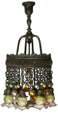 Louis Comfort Tiffany Favrile Glass and Bronze Eight-Light Moorish Chandelier dating from 1899-1920 (Estimate: $30,000-50,000).