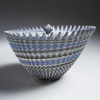 A marbleized stoneware vessel made by Ogata Kamio (1949- ).  The artist's chosen technique is neriage, in which an assemblage of hundreds of paper-thin layers of colored clay produces a ceramic work with striated linear patterns, 2015.