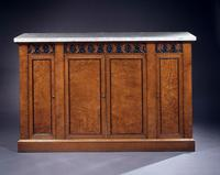 Regency pollard oak and parcel-ebonized side cabinet on a plinth base with fossil marble top (one of a pair)