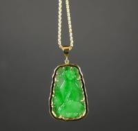 18kt yellow gold jade and diamond pendant necklace.