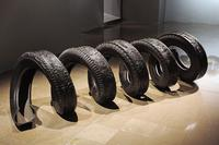 "Betsabee Romero, ""Espiral Sin Fin,"" 2008.  Five carved tires, 33 7/16 x 33 7/16 x 78 3/4 inches."