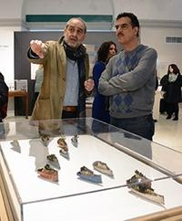 Issam Kourbaj, on left, talks with Museum visitors in the special exhibition.
