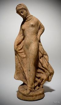 Greek (Hellenistic) Tanagra figurine of a standing draped woman late 3rd century B.C.E.  (probably modern) Terracotta overall: 8 1/4 in.  x 3 3/4 in.  x 3 in.  (21 cm x 9.5 cm x 7.6 cm) Gift of Mrs.  Brooks B.  Thayer (Louise Govett, Class of 1956) 1977.25