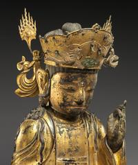 Seated Bodhisattva.  Korea, Joseon dynasty (1392–1910), ca.  mid-17th century.  Gilt wood, H.  20 1/4 in.  Mary Griggs Burke Collection, Gift of the Mary and Jackson Burke Foundation, 2015 (2015.300.301a–c)