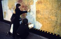 Three Weeks in May, Suzanne Lacy, 1977.  Courtesy of Suzanne Lacy.  Pictured, Katja Beisanz stamps a rape report on the map of Los Angeles