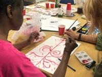 "The art therapy practice at ARTREHUB is built around the ""Red Thread Technique,"" a means of enhancing connectedness, which was developed by the project's founder, Zinaïda Kubar."