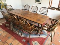 This antique English oak folding top dining table ($3/6,000) has leaves that fold up to form a buffet/sideboard or down to make a dining table.