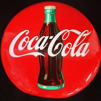 A vintage Coca-Cola button sign marked AM 74 under bottle, 24 inch diameter, is represented in the sale.