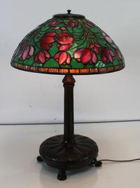 Lighting up the block was this Tiffany Studios Crocus table lamp, signed on the base and shade having a 16-inch diameter that earned $33,750.