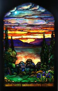 Earning $57,475 was this Tiffany Studios landscape window showing a single acid-etched star in the sunset sky with purple mountains and a lake reflection.