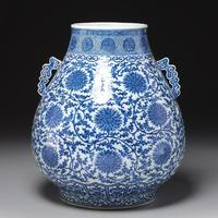 This large Qianlong blue and white floral vase, Qing dynasty, 19 inches tall, having a blue underglaze and Imperial Qianlong mark, quadrupled its high estimate to bring $27,500.