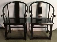 A pair of antique Asian horseshoe armchairs, black lacquer, 39 by 27 by 24 inches, leads a fine grouping of Chinese furniture and arts.