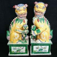A pair of imperial yellow temple lions, circa 1860-1880, from the Nanking Province, 17 ½ inches tall, fetched $1,079.