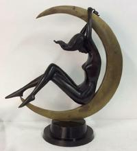 The top lot of the action was a bronze Art Deco statuette of a nude woman reclining inside a crescent moon, 23 by 20 by 9 inches, that went to a phone bidder for $1,905.