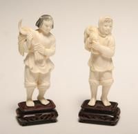 Pair of Chinese Ivory figurines: $1,150
