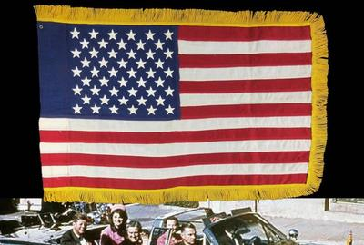 The American flag attributed and documented to have been flying over the right front bumper of the presidential limousine in the Dallas motorcade on Nov.  22, 1963 (est.  $50,000-$60,000).