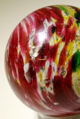 Giant onion skin marble with mica, circa 1860s-1880s, two inches in diameter, a beautiful specimen with multi-colored splotches and mica flakes scattered throughout the body ($1,475).