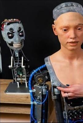 Ai-Da Robot with researcher Lucy Seal