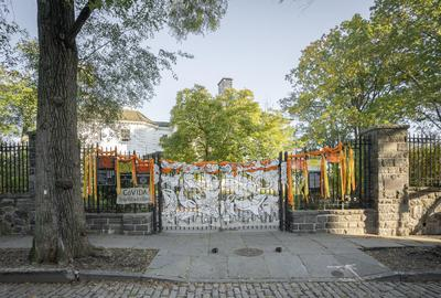 "Andrea Arroyo, ""CoVIDA: Homage to Victims of the Pandemic,"" Mixed media, vinyl, flowers, ribbons, papel picado, Morris-Jumel Mansion at Roger Morris Park, 2020.  Photo: Bruce Katz"