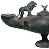 Large Byzantine double-spouted bronze lamp from the 6th or 7th century AD, 9 ¾ inches tall, a lovely example on a flared pedestal foot with an elegant rounded body (est.  7,000-$10,000).
