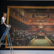 Banksy, Devolved Parliament, brought an artist auction record of $12.2 million at Sotheby's London.