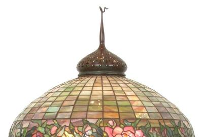 "The top lot of the auction was this Tiffany Studios ""Peony Border"" floor lamp that earned $151,250."
