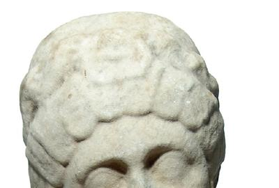 Lovely Roman marble head of a woman from the later 4th century AD, 10 inches tall, with attractive features, nice detail and a gentle expression (est.  $9,000-$12,000).