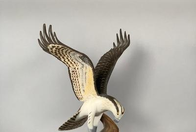 Hand-carved and painted figure of an Osprey hawk by artist Wendell Gilley (Maine, 1904-1983), depicting the Osprey in flight landing on a driftwood branch, artist signed (est.  $250-$450).