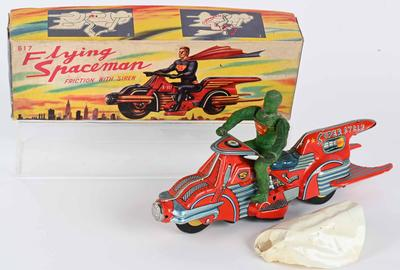 "Bandai (Japan) friction-powered 'Flying Spaceman' on 'Super Cycle' with original caped, green rubber ""Superman"" figure.  Accompanied by colorfully illustrated box lid.  The top lot of the sale, it sold for $55,200 against an estimate of $15,000-$25,000."